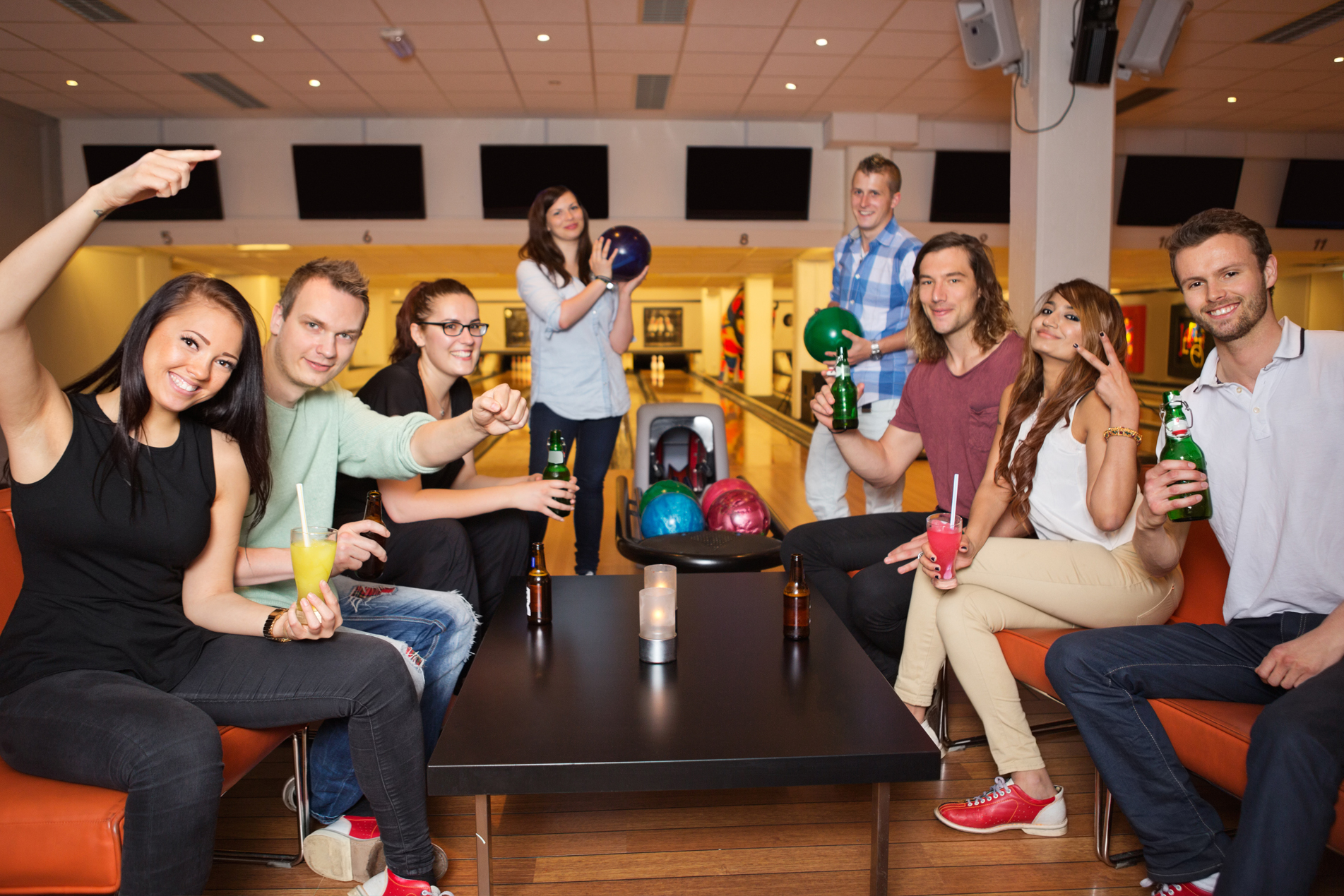 Group of friends at the bowling center having a good time